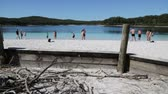 purê : AUSTRALIA, LAKE MCKENZIE-CIRCA AUGUST 2017-unidentified people in the beach