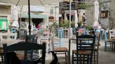 nicosia : CYPRUS, NICOSIA-CIRCA APRIL 2018 - unidentified people outside the bar of the town center Stock Footage