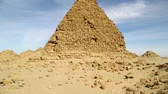 camel : in africa sudan napata karima the antique pyramids of the black pharaohs in the middle of the desert