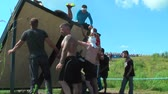 inclinado : Athletes storm wall in extrim race. Tyumen.Russia