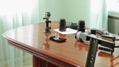 gravador : Action camera, microphone, photo lens and audio recorder on table