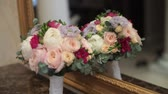 wedding : Bridal bouquet near mirror indoors Stock Footage