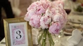 пион : Bouquet with peonies on a table decoration Стоковые видеозаписи