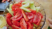 cooks : Cooking vegetable salad with cucumber and tomato