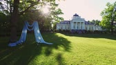 konak : Wedding ceremony decoration near palace in a park aerial Stok Video