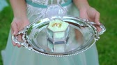 jewelry box : Bride holding plate with wedding rings in a blue box