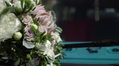 old : Bridal bouquet on a hood of blue retro old bus Stock Footage