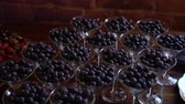 meyve : Blueberry in glasses at buffet Stok Video
