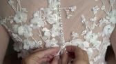 dantel : Bride wearing wedding bridal dress Stok Video