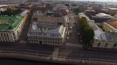 Aerial drone view of historical city center embankment in european city. Saint-Petersburg in Russia. Old buildings near river. Sunny summer day. Stok Video