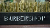 barber hair cut : Barber shop logo text outdoors in a city. Street sign