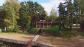 házikó : A wooden cottage near lake or sea. Luxury house for vacations. Summer day