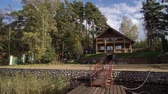 ormanda yaşayan : A wooden cottage near lake or sea. Luxury house for vacations. Summer day