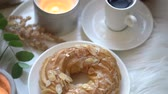 aconchegante : Cozy breakfast at home with cup of coffee, custard cake and burning candles Vídeos
