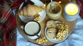 stilleben : Simple country home breakfast in bed, coffee with milk and homemade pastry on plaid blanket