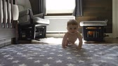 nemluvně : happy little baby boy crawling on floor at home