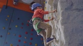 corajoso : little active boy climbing at indoor