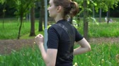 cipő : Young woman sprinter running in park at summertime With green grass background Slow motion