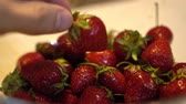 métrico : Mens hand take and rotate fresh and ripe strawberries Close up