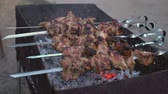 mutton : Tasty shish kebab preparing on a grill.