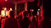 Shooting video with smartphone at outdoor festival night party concert Original multi colored lights blurred background Stock Footage