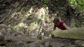 Young beautiful barefoot woman walks in mountain forest on the river Wideo