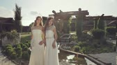 swarovski : Attractive girl in expensive wedding dresses posing in a magical garden Stock Footage