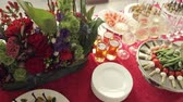 decor : Variety of tasty snacks, canapes, alcohol and water in the cups at the banquet on catering