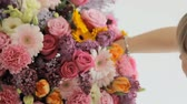 perfume : Florist makes a beautiful bouquet from different flowers
