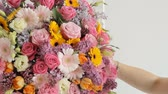 goździk : Close-up of a huge bouquet consisting of lilacs, roses, tulips, lilies, carnations and other colorful flowers