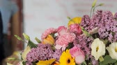 gerbera : Modern florist makes a bouquet to decorate the hall before holidays