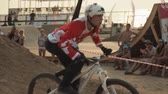 Extreme rider making  stunts on the bike. Dirt jumping competition.