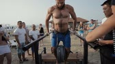 Sports man pushed with the weight on the parallel bars. The Street workout
