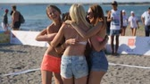 Young attractive girls in short shorts are having fun and celebrating their victory on the beach Vídeos