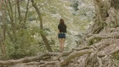 Woman walks through the forest
