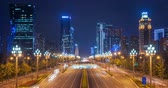 bulvár : Chengdu, Sichuan Province, China - Sept 27, 2018: Traffic light trails on the Tianfu Avenue at night with illuminated skyscrapers in the background Dostupné videozáznamy