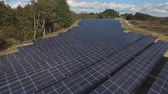 коллектор : Solar panels in wooded area (Drone footage)