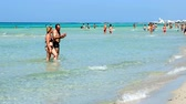 кристаллический : holiday makers walk beach Torre San Giovanni crystalline waters Ionian sea
