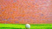 gridiron : Bouncing football Ball against Wall