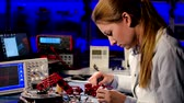 html : Scientist adjusts the robot arm