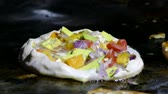 rice pan : zanzibar pizza on a frying pan in forodhani garden Stock Footage