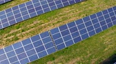 grid : Aerial flight over blue solar panels