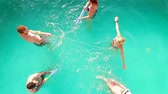 смех : Aerial flight : Happy group of friends enjoying summer pool party splashing in water Стоковые видеозаписи
