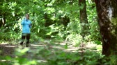 front view : running jogging in forest. woman training, running, jogging, fitness, runner-4k video Stock Footage