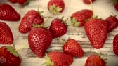 Fresh and ripe strawberries on a wooden table- hd video Dostupné videozáznamy