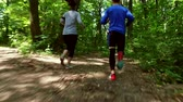 front : Runners - running jogging in forest. People training, running, jogging, fitness, runner-4k video