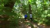 outdoor pursuit : running jogging in forest. woman training, running, jogging, fitness, runner-4k video Stock Footage