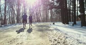 couple winter running  in snow Wideo
