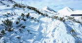 Aerial flight over snowy mountain at winter