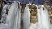 Waterfall in the National Park Slovak Karst, in the village named Haj district Kosice, Slovakia in winter. Стоковые видеозаписи